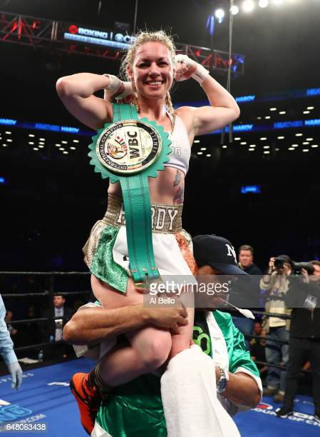 Heather Hardy celebrates her decision win against Edina Kiss during their Super Bantamweight bout at the Barclays Center in Brooklyn New York on...