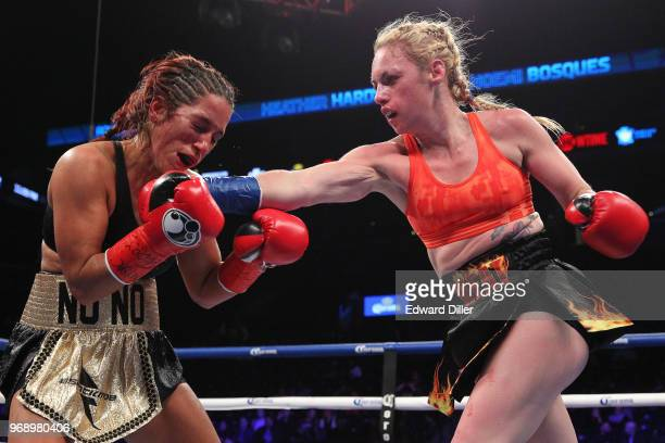 Heather Hardy lands a right hand against Noemi Bosques at the Barclays Center in the Brooklyn borough of New York City NY on December 05 2015 Hardy...