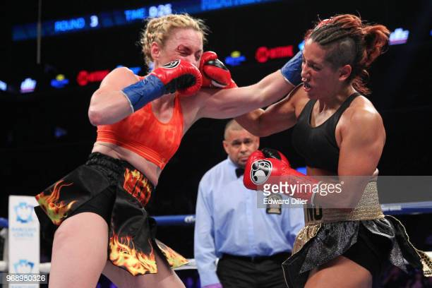 Heather Hardy trades punches with Noemi Bosques at the Barclays Center in the Brooklyn borough of New York City NY on December 05 2015 Hardy would...