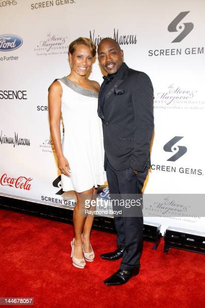 Heather Hayslett and movie producer Will Packer poses for photos on the red carpet during the Steve Marjorie Harvey Foundation Gala at Cipriani Wall...