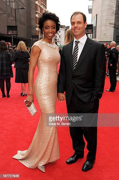 Heather Headley and Brian Musso arrive at The Laurence Olivier Awards 2013 at The Royal Opera House on April 28 2013 in London England