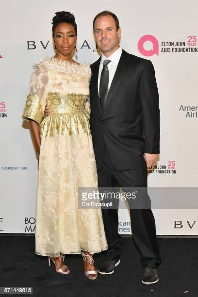 Heather Headley and Brian Musso attend the Elton John AIDS Foundation 25th Year And Honors Founder Sir Elton John During New York Fall Gala at...