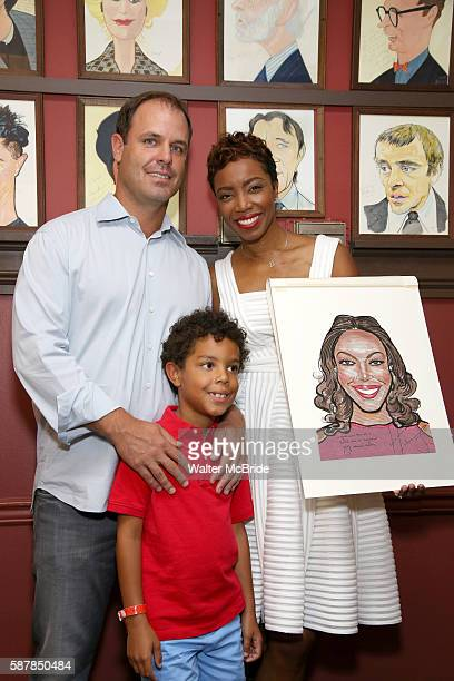 Heather Headley with her husband Brian Musso and son John David attend the unveiling of Heather Headley's Portrait on the Sardi's Wall of Fame at...