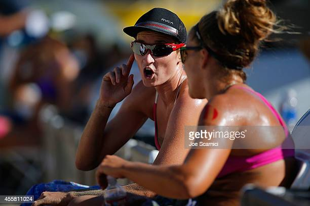 Heather Hughes and Brooke Sweat talk on the chairs between points at the AVP Championships at Huntington Beach on September 20 2014 in Huntington...