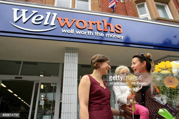 Heather Ikin and her threeyearold daughter Hannah from Westham near Weymouth with a bouquet of flowers and two bags of goodies which they purchased...