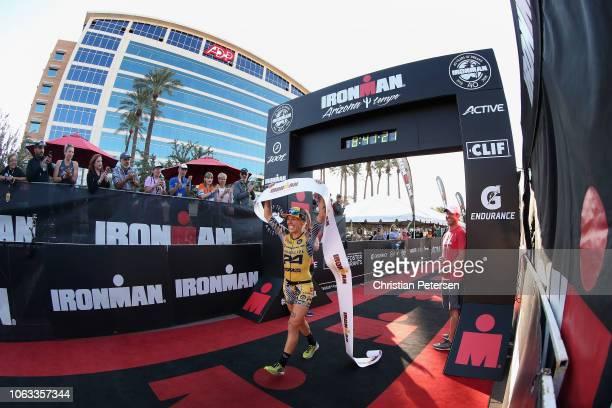Heather Jackson celebrates after winning the Top Pro Women of the 2018 Ironman Arizona at Tempe Town Lake on November 18 2018 in Tempe Arizona