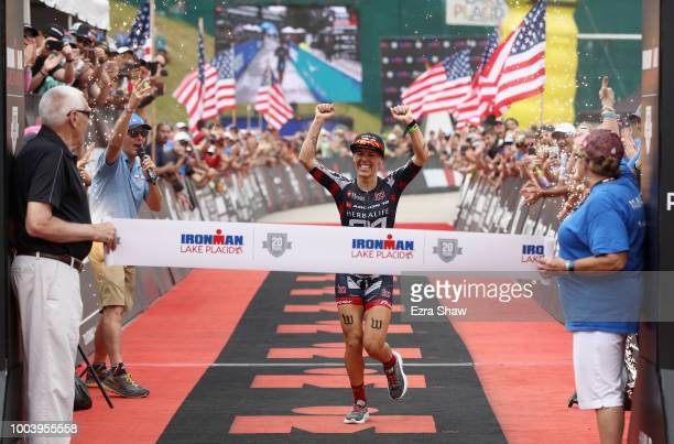 Heather Jackson crosses the finish line to win the Women's IRONMAN Lake Placid on July 22 2018 in Lake Placid New York