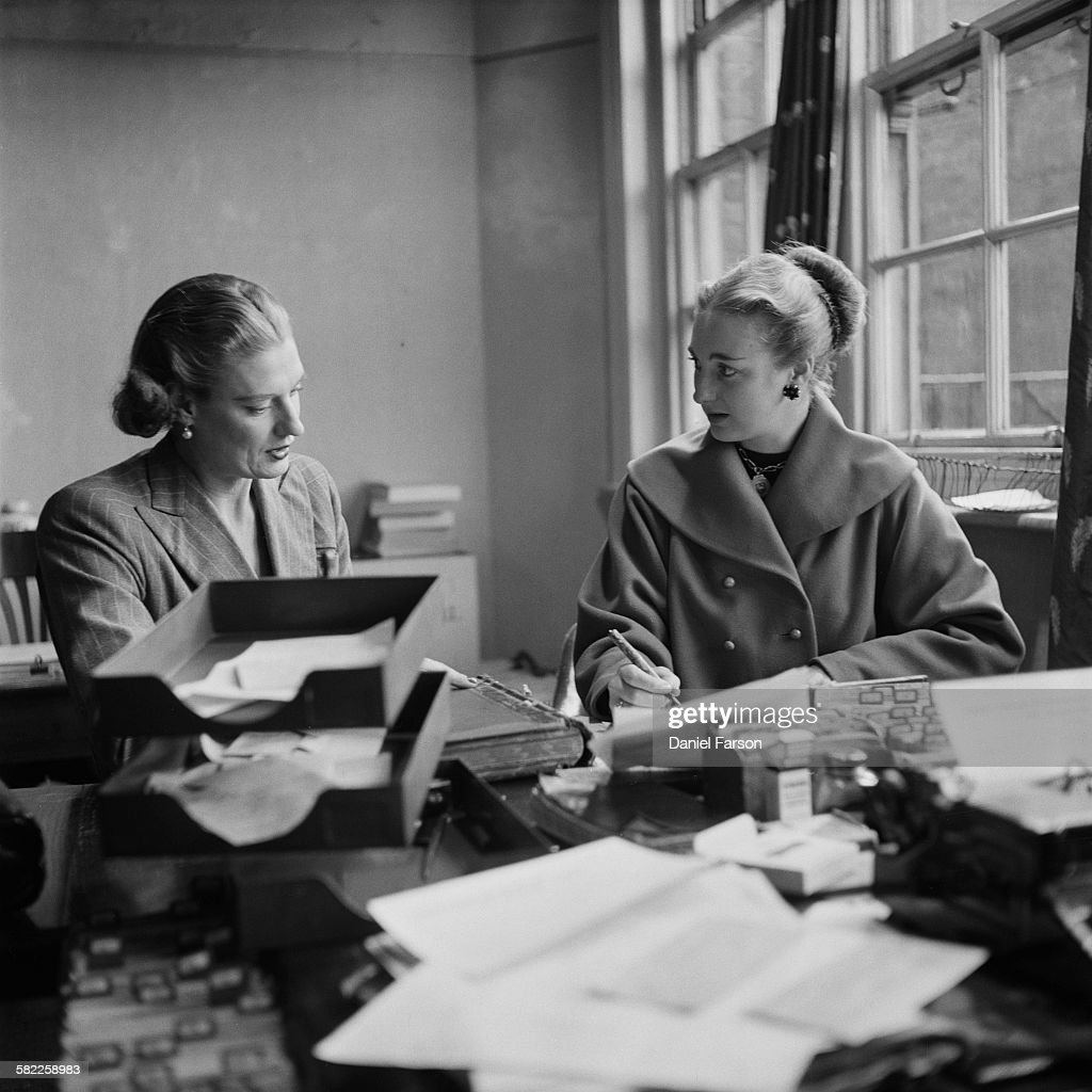 Heather Jenner (born Heather Lyon, left), founder of the Marriage Bureau dating agency in Bond Street, London, registers a new client, a 21-year-old actress named Pam, December 1952. Jenner runs the agency with her business partner, Mary Oliver. Original Publication: Picture Post - 6238 - Another Marriage Has Been Arranged - pub. 20th December 1952
