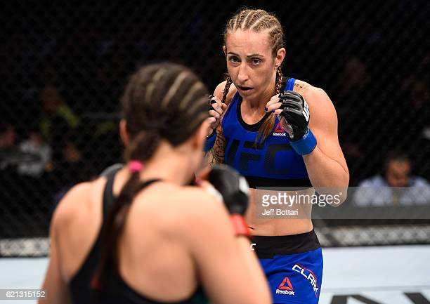 Heather Jo Clark of the United States circles Alexa Grasso of Mexico in their women's strawweight bout during the UFC Fight Night event at Arena...