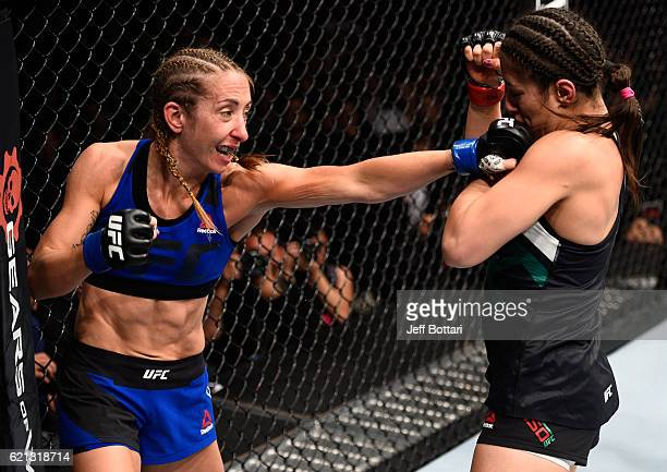 Heather Jo Clark of the United States punches Alexa Grasso of Mexico in their women's strawweight bout during the UFC Fight Night event at Arena...