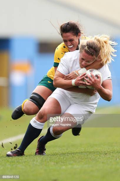 Heather Kerr of England is tackled by Kiri Lingman of Australia during the Women's International Test match between the Australian Wallaroos and the...