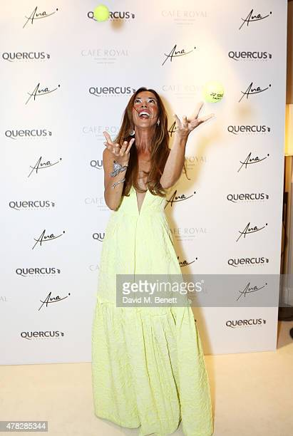 Heather Kerzner juggles with tennis balls as she arrives at the Quercus Foundation PreWimbledon Cocktails with Ana Ivanovic in the Ten Room at Hotel...