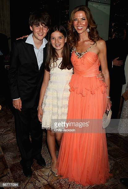 Heather Kerzner poses for a photograph with her children at the Grand Opening of the new OneOnly Cape Town resort on April 2 2009 in Cape Town South...