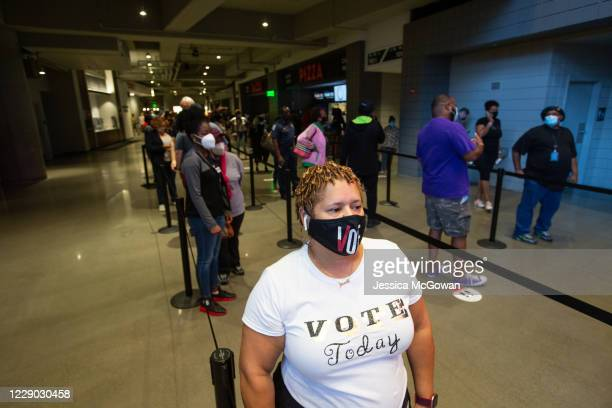 Heather King waits in line at State Farm Arena, Georgia's largest early voting location, to cast her ballot during the first day of early voting in...