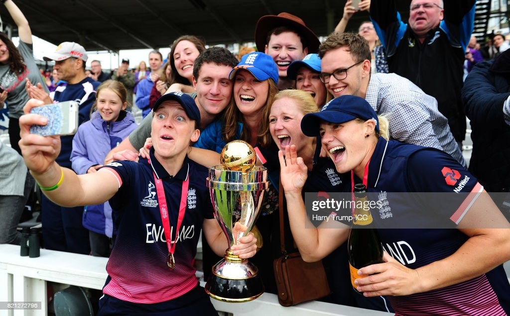 Heather Knight and Katherine Brunt of England pose for a selfie with the trophy during the ICC Women's World Cup 2017 Final between England and India at Lord's Cricket Ground on July 23, 2017 in London, England.