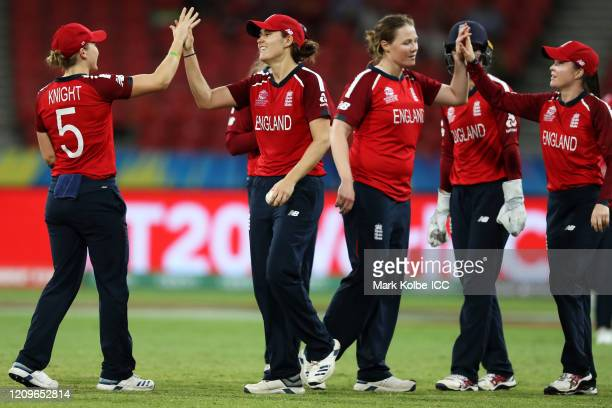 Heather Knight and Natalie Sciver of England celebrate after Scriver caught Lee-Ann Kirby of West Indies during the ICC Women's T20 Cricket World Cup...