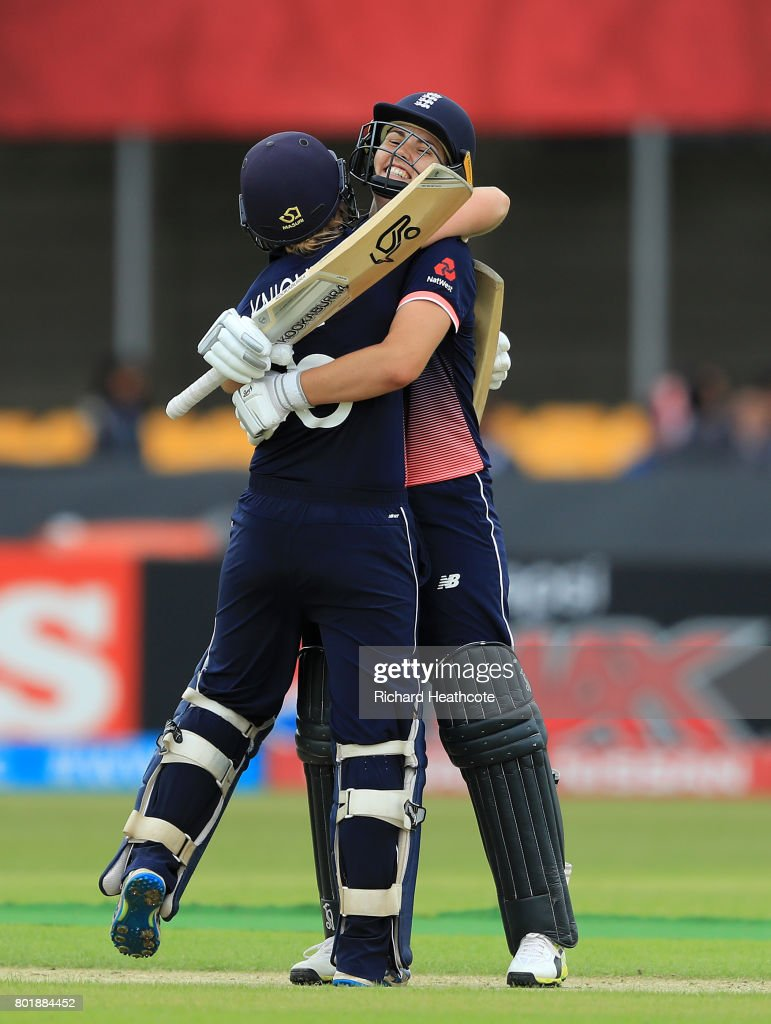Heather Knight and Natalie Sciver of England celebrate both of them reaching their centuries during the Women's ICC World Cup group match between England and Pakistan at Grace Road on June 27, 2017 in Leicester, England.