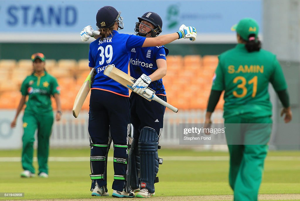 Heather Knight and Natalie Sciver of England celebrate victory after the 1st Royal London ODI match between England Women and Pakistan Women at Grace Road Cricket Ground on June 21, 2016 in Leicester, England.