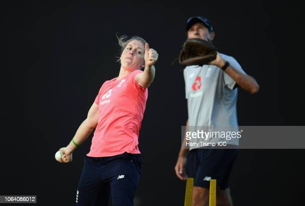 Heather Knight Captain of England bowls as Mark Robinson Head Coach of England looks on during an England Nets Session and Press Conference at the...