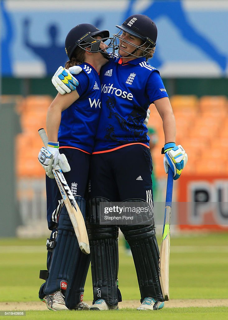 Heather Knight celebrates reaching 50 runs with Natalie Sciver of England during the 1st Royal London ODI match between England Women and Pakistan Women at Grace Road Cricket Ground on June 21, 2016 in Leicester, England.
