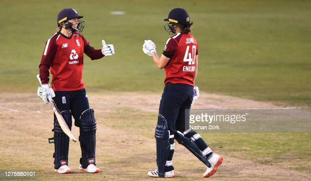Heather Knight fist pumps Amy Jones of England during the 2nd Vitality IT20 match between England Women and West Indies Women at the Incora County...