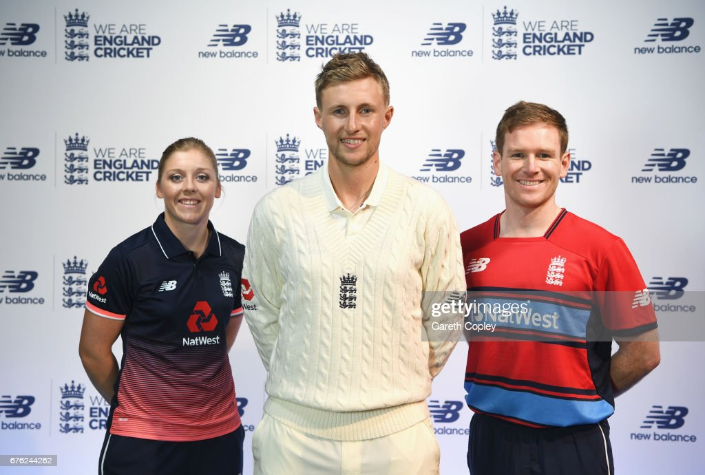Heather Knight, Joe Root and Eoin Morgan of England pose during the New Balance England Cricket Kit Launch at the New Balance store, Oxford Street on May 2, 2017 in London, England.