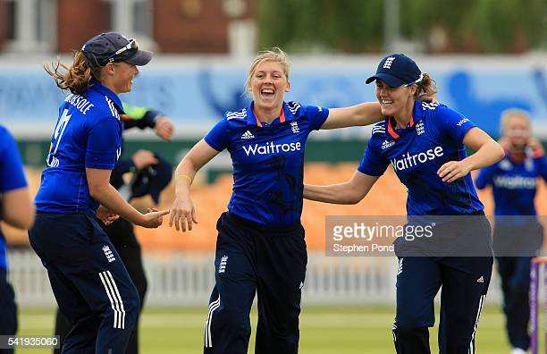 Heather Knight of England and team mates celebrate after bowling out Pakistan for 165 during the 1st Royal London ODI match between England Women and...