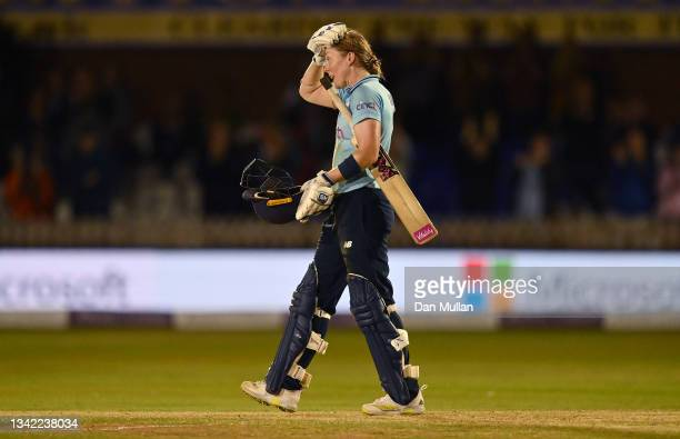 Heather Knight of England celebrates scoring a century during the 4th One Day International match between England and New Zealand at The Incora...