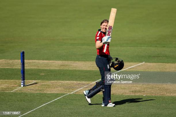 Heather Knight of England celebrates scoring a century during the ICC Women's T20 Cricket World Cup match between England and Thailand at Manuka Oval...
