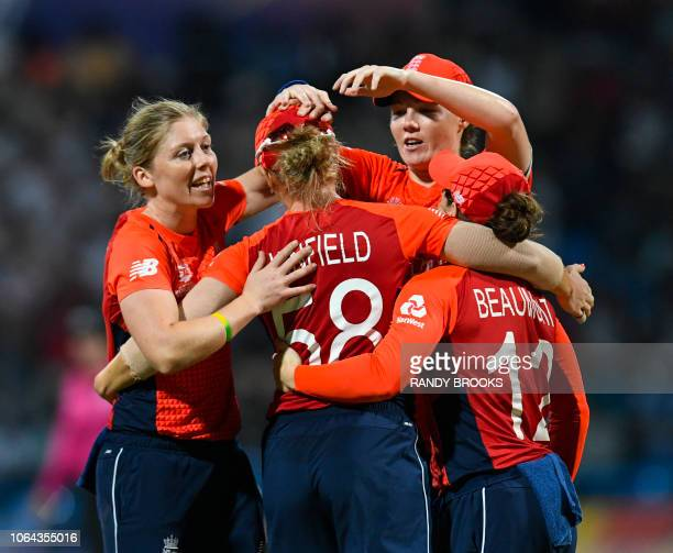 Heather Knight of England celebrates the dismissal of Anuja Patil of India during the ICC Women's World T20 2nd semifinal match between England and...