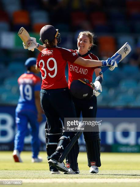 Heather Knight of England celebrates with Natalie Sciver of England after reaching her century during the ICC Women's T20 Cricket World Cup match...