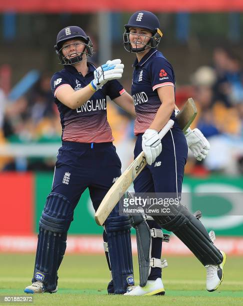 Heather Knight of England ceongratulates Natalie Sciver of England on her century during the ICC Women's World Cup 2017 match between England and...