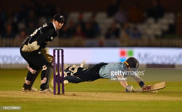 Heather Knight of England dives to make her ground and score a century during the 4th One Day International match between England and New Zealand at...
