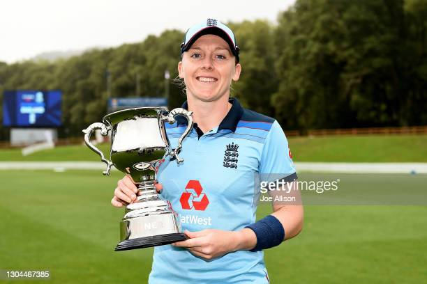 Heather Knight of England holds the series trophy during game three of the One Day International series between New Zealand and England at University...