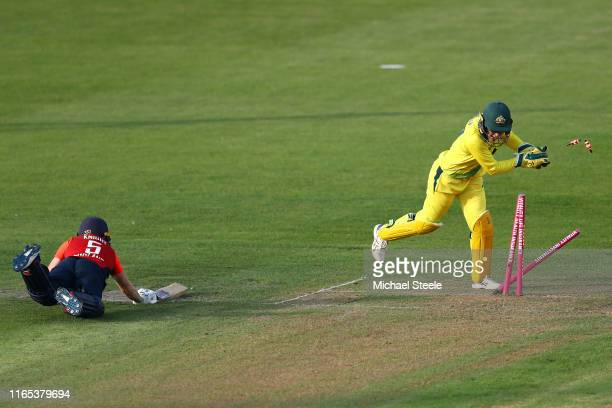Heather Knight of England is run out as Australia wicketkeeper Alyssa Healy breaks the stumps during the 3rd Vitality Women's IT20 at The County...