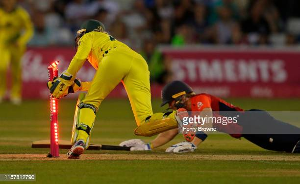 Heather Knight of England is run out by Beth Mooney of Australia during the England v Australia 1st Vitality Women's IT20 match at Cloudfm County...