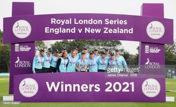 Heather Knight of England lifts the trophy as she celebrates victory in the series with her team mates after the 5th One Day International match...