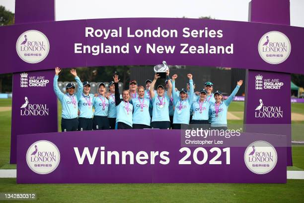 Heather Knight of England lifts the trophy as they celebrate their series victory during the 5th One Day International match between England and New...