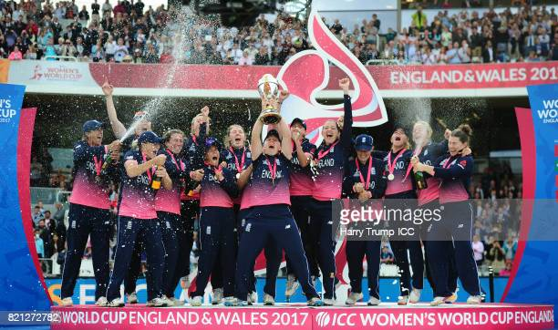 Heather Knight of England lifts the World Cup trophy as the rest of the side celebrate during the ICC Women's World Cup 2017 Final between England...