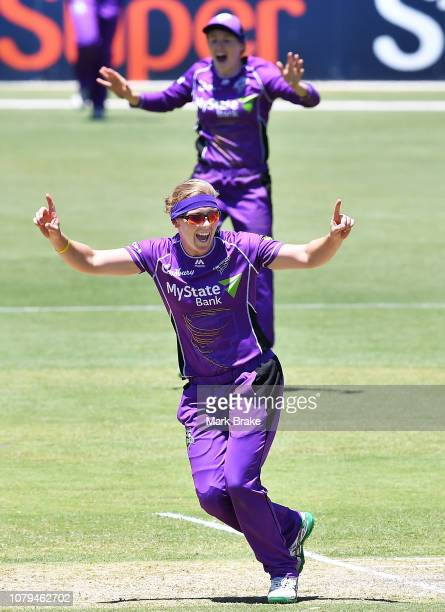 Heather Knight of the Hobart Hurricanes celebrates after taking the wicket of Bridget Patterson of the Adelaide Strikers during the Adelaide Strikers...
