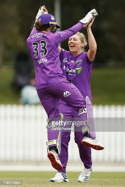 Heather Knight of the Hurricanes celebrates a wicket with Emily Smith of the Hurricanes during the Women's Big Bash League match between the...