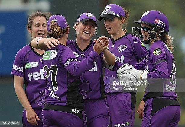 Heather Knight of the Hurricanes celebrates after taking a catch to dismiss Emma Kearney of the Melbourne Stars during the Women's Big Bash League...