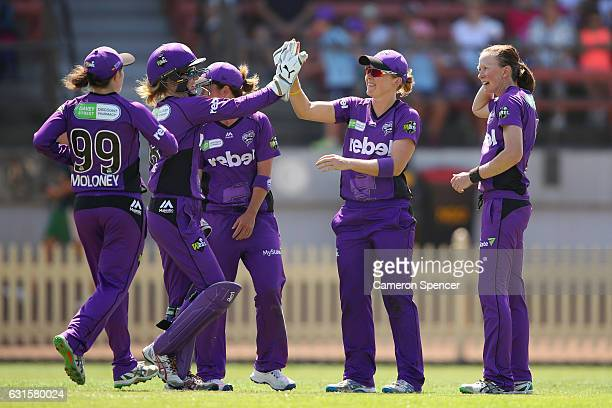 Heather Knight of the Hurricanes is congratulated by team mates after catching Amy Jones of the Sixers off a delivery by team mate Veronica Pyke...