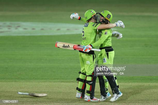 Heather Knight of the Thunder and Rachael Haynes of the Thunder celebrate victory during the Women's Big Bash League Final between the Melbourne...