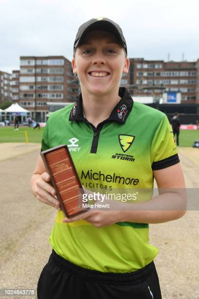 Heather Knight of Western Storm and England is presented with a limited edition Wisden Cricketer's Almanack as one of Wisden's 5 Cricketers of the...