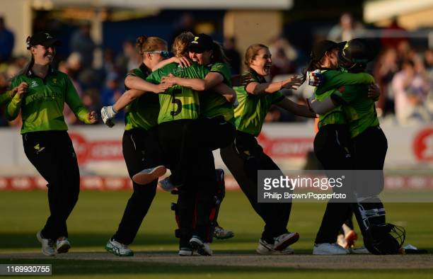 Heather Knight of Western Storm and teammates celebrate after hitting the winning runs as Suzie Bates of Southern Storm looks on in the Kia Super...