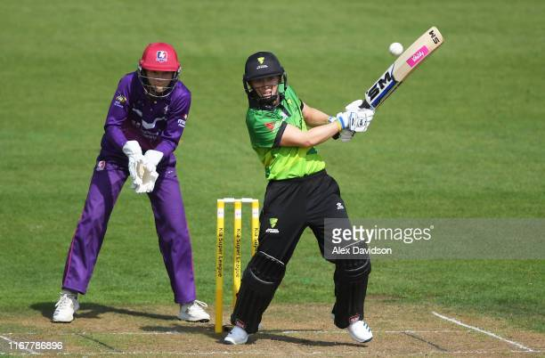 Heather Knight of Western Storm bats watched on by Amy Jones of Loughborough Lightning during the Kia Super League match between Western Storm and...