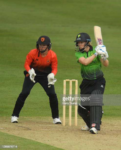 Heather Knight of Western Storm plays a shot as Carla Rudd of Southern Vipers looks on during the Rachael HeyhoeFlint Trophy match between Western...