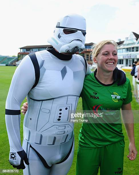 Heather Knight of Western Storm poses with a spectator in a stormtroopers outfit during the KSL match between Western Storm and Lancashire Thunder at...
