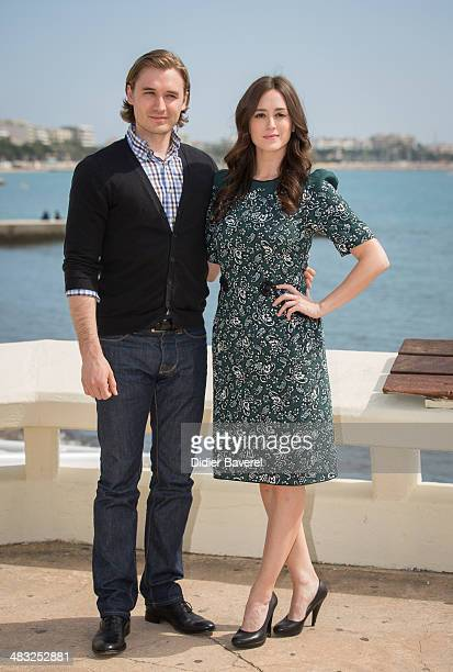 Heather Lind and Seth Numrich pose during the photocall of 'Turn' at MIPTV 2014 at Hotel Majestic on April 7 2014 in Cannes France